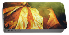 Portable Battery Charger featuring the photograph Withered Leaves by Silvia Ganora