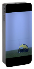 Wolverine Helmet On The Field In Heavy Fog Portable Battery Charger