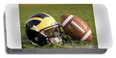 Wolverine Helmet With Football On The Field Portable Battery Charger