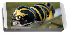 Wolverine Helmets On A Bench Portable Battery Charger