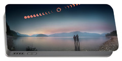 Portable Battery Charger featuring the photograph Woman And Girl Standing In Lake Watching Solar Eclipse by William Lee