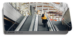 Woman Going Up Escalator In Milan, Italy Portable Battery Charger