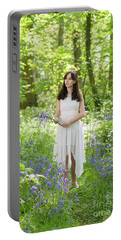 Woman Walking Through Bluebells Portable Battery Charger
