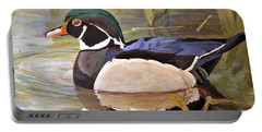 Wood Duck On Pond Portable Battery Charger by Laurie Rohner