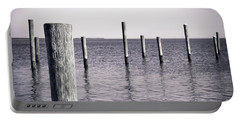 Portable Battery Charger featuring the photograph Wood Pilings In Monotone by Colleen Kammerer