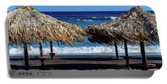 Wood Thatch Umbrellas On Black Sand Beach, Perissa Beach, In Santorini, Greece Portable Battery Charger