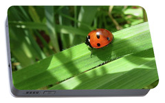 Portable Battery Charger featuring the photograph World Of Ladybug 1 by Jean Bernard Roussilhe