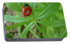 Portable Battery Charger featuring the photograph World Of Ladybug 3 by Jean Bernard Roussilhe