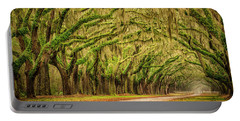 Portable Battery Charger featuring the photograph Wormsloe Drive by Phyllis Peterson