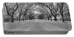 Portable Battery Charger featuring the photograph Wormsloe Pathway by Jon Glaser
