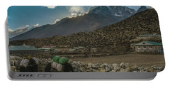 Portable Battery Charger featuring the photograph Yaks Moving Through Dingboche by Mike Reid