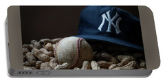 Portable Battery Charger featuring the photograph Yankee Cap Baseball And Peanuts by Terry DeLuco