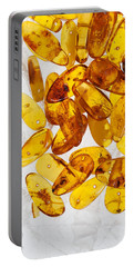 Portable Battery Charger featuring the photograph Yellow Amber Stones  by Andrey  Godyaykin