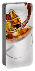 Portable Battery Charger featuring the photograph Yellow Amber Stones In A Glass. by Andrey  Godyaykin