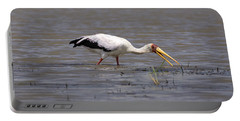 Yellow Billed Stork Wading In The Shallows Portable Battery Charger by Aidan Moran