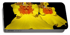 Portable Battery Charger featuring the photograph Yellow Dresses by Judy Vincent