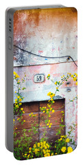 Yellow Flowers And Decayed Wall Portable Battery Charger