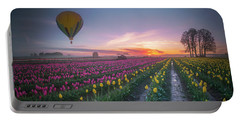 Portable Battery Charger featuring the photograph Yellow Hot Air Balloon Over Tulip Field In The Morning Tranquili by William Lee