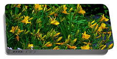 Portable Battery Charger featuring the photograph Yellow Lily Flowers by Susanne Van Hulst