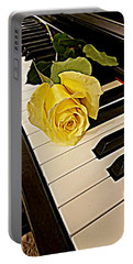 Yellow Rose On Piano Keys Portable Battery Charger