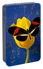 Yellow Tulip With Orange And Black Butterfly Portable Battery Charger by Garry Gay