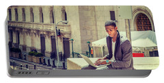 Young African American Man Working On Wall Street In New York Portable Battery Charger
