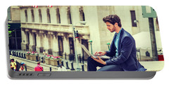 Young Businessman Working On Wall Street In New York Portable Battery Charger
