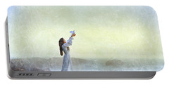 Young Lady Releasing A Dove By The Sea Portable Battery Charger