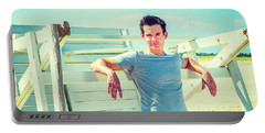 Young Man Relaxing On The Beach Portable Battery Charger