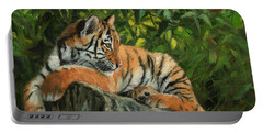Young Tiger Resting On Rock Portable Battery Charger by David Stribbling