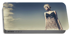 Young Woman Standing On The Beach Portable Battery Charger