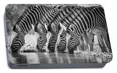 Zebras Drinking Portable Battery Charger by Inge Johnsson
