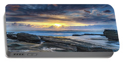 An Atmospheric Coastal Sunrise Portable Battery Charger