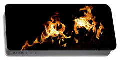 Flames In The Fire Of A Red And Yellow Barbecue. Portable Battery Charger