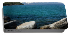 Rocks In A Lake With Mountain Range Portable Battery Charger