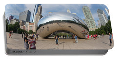 Visitors And Tourists Take Photos Of Cloud Gate, The Bean, Sir A Portable Battery Charger