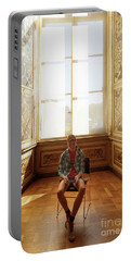 Portable Battery Charger featuring the photograph A Boy At The Louvre by Craig J Satterlee