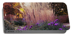 A Flower Bed In The Autumn Park Portable Battery Charger