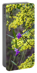 Portable Battery Charger featuring the photograph A Little Bit Of Purple Coral Pea by Elaine Teague