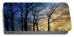 Portable Battery Charger featuring the photograph A Prairie Winter Sunset by Philip and Karen Rispin