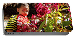 A Small Person With Reflected Flowers Portable Battery Charger