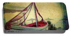 Portable Battery Charger featuring the photograph an Old Boat by Milena Ilieva