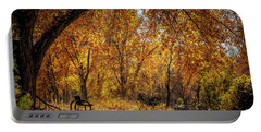 Bench With Autumn Leaves  Portable Battery Charger
