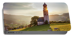Black Head Sheep Graze By A Church In Alps Portable Battery Charger