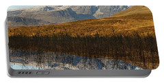 Portable Battery Charger featuring the photograph Blue Skye by Stephen Taylor