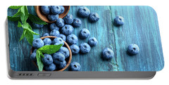 Bowl Of Fresh Blueberries On Blue Rustic Wooden Table From Above Portable Battery Charger
