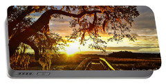 Portable Battery Charger featuring the photograph Breaking Sunset by Robert Knight