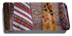 Bright Colored Patterns On Throw Rugs In The Medina Bazaar  Portable Battery Charger
