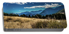 Brown Grass And Mountains Portable Battery Charger
