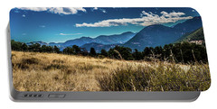 Portable Battery Charger featuring the photograph Brown Grass And Mountains by James L Bartlett